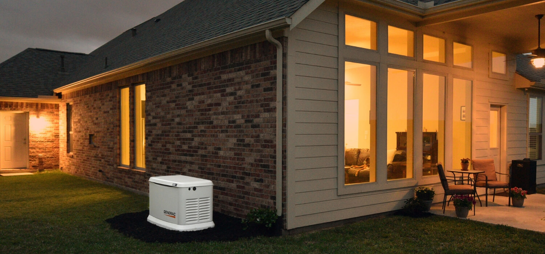 generator beside brick house at night