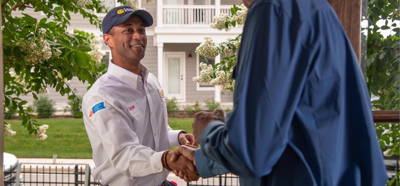 technician greeting customer