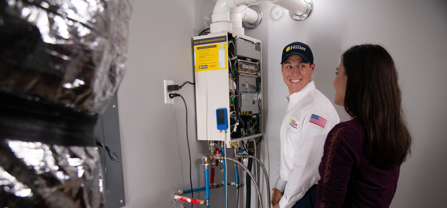 technician repairs tankless water heater