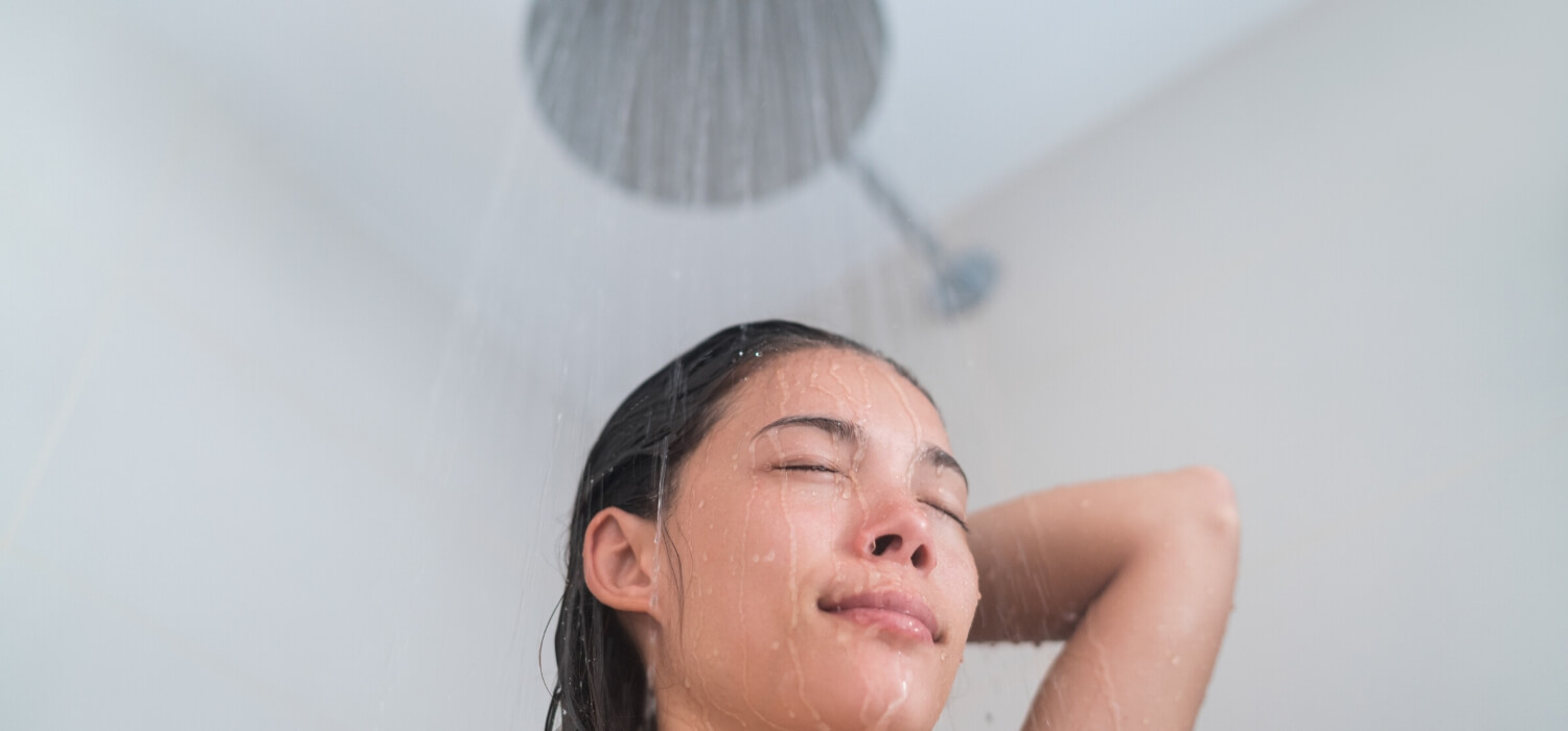 taking shower from water heater