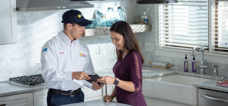 electrician explaining repairs to customer