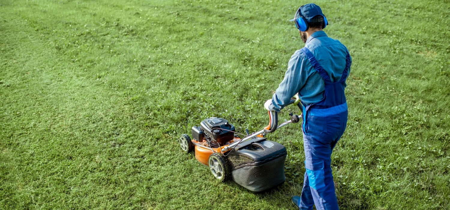 mower wearing protective hearing