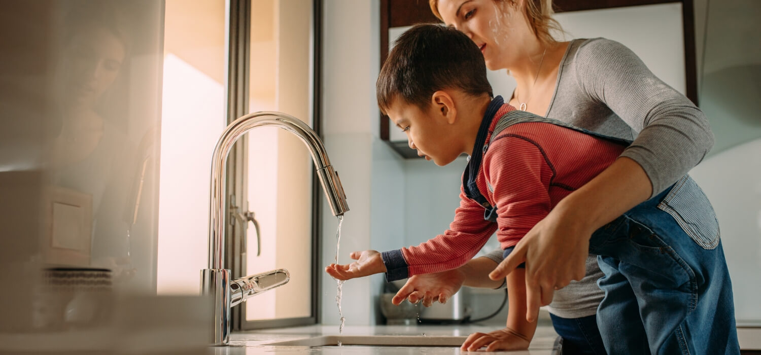 child washing hands with no hot water