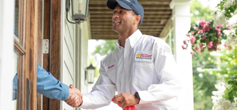 Hiller technician greeting homeowner