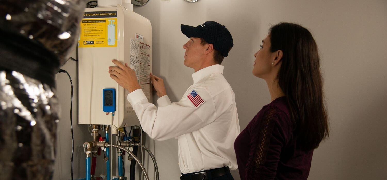 tech showing customer tankless water heater