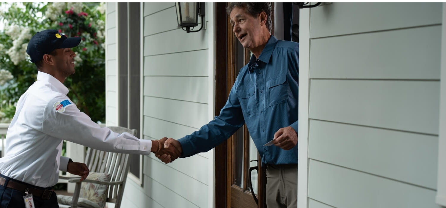 homeowner greeting technician for home upgrade