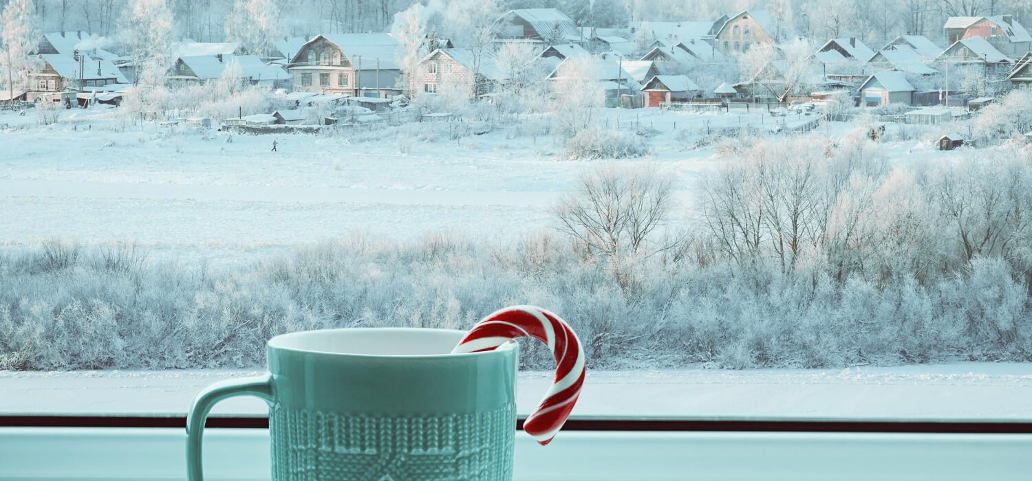 hot drink at window with snow in background