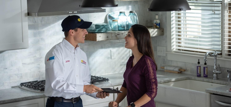 technician helping customer save money