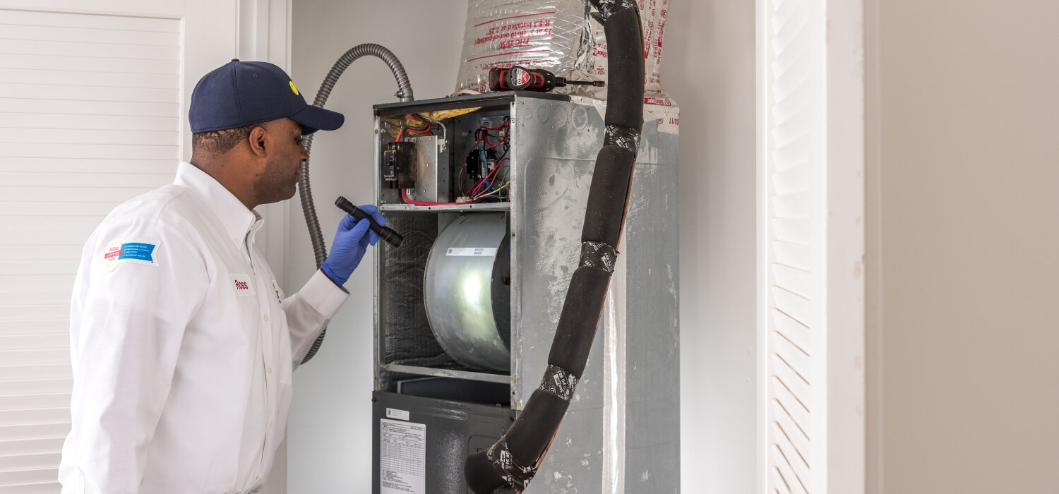 hvac tech performing heating tune-up