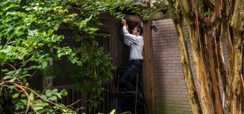 technician installing smart home camera