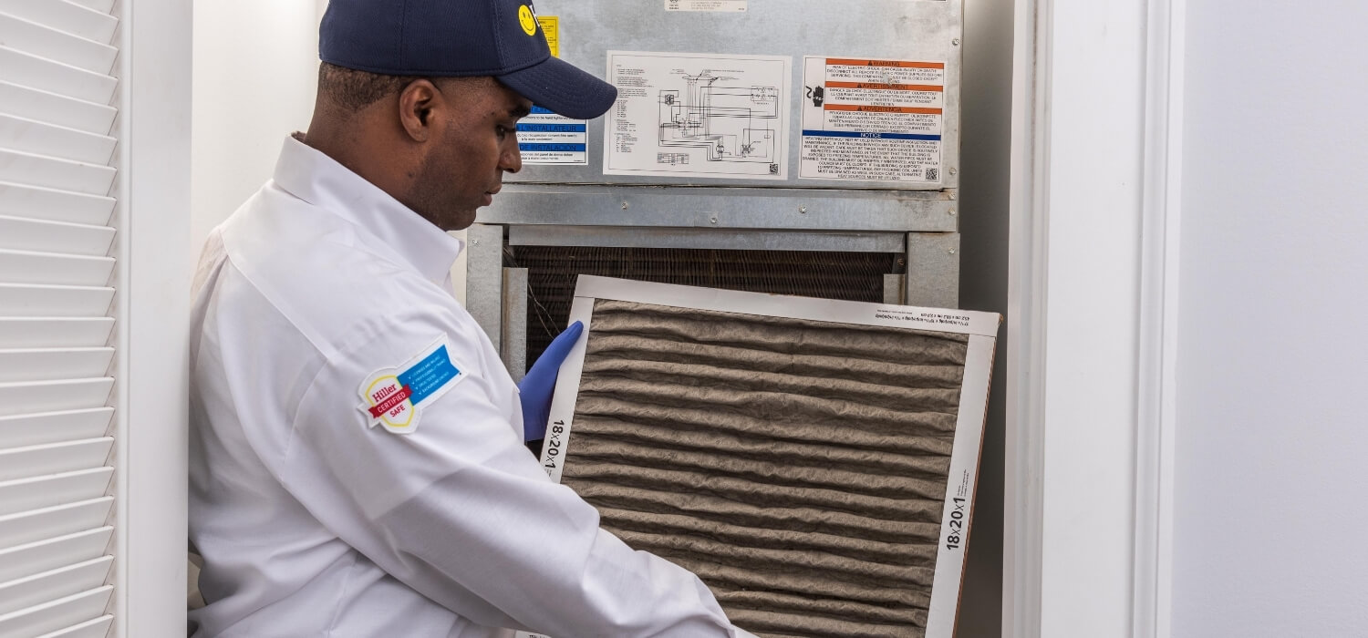 HVAC Technician Replacing Dirty Air Filter Causing The Furnace To Blow Cold Air