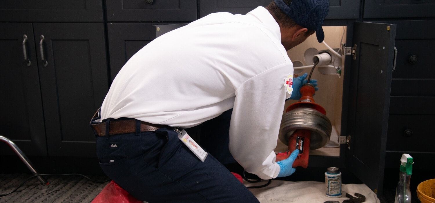 Plumber Snaking Drain Making Sure Everything Stays Clean