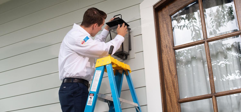 Electrician Fixing Outdoor Flickering Light