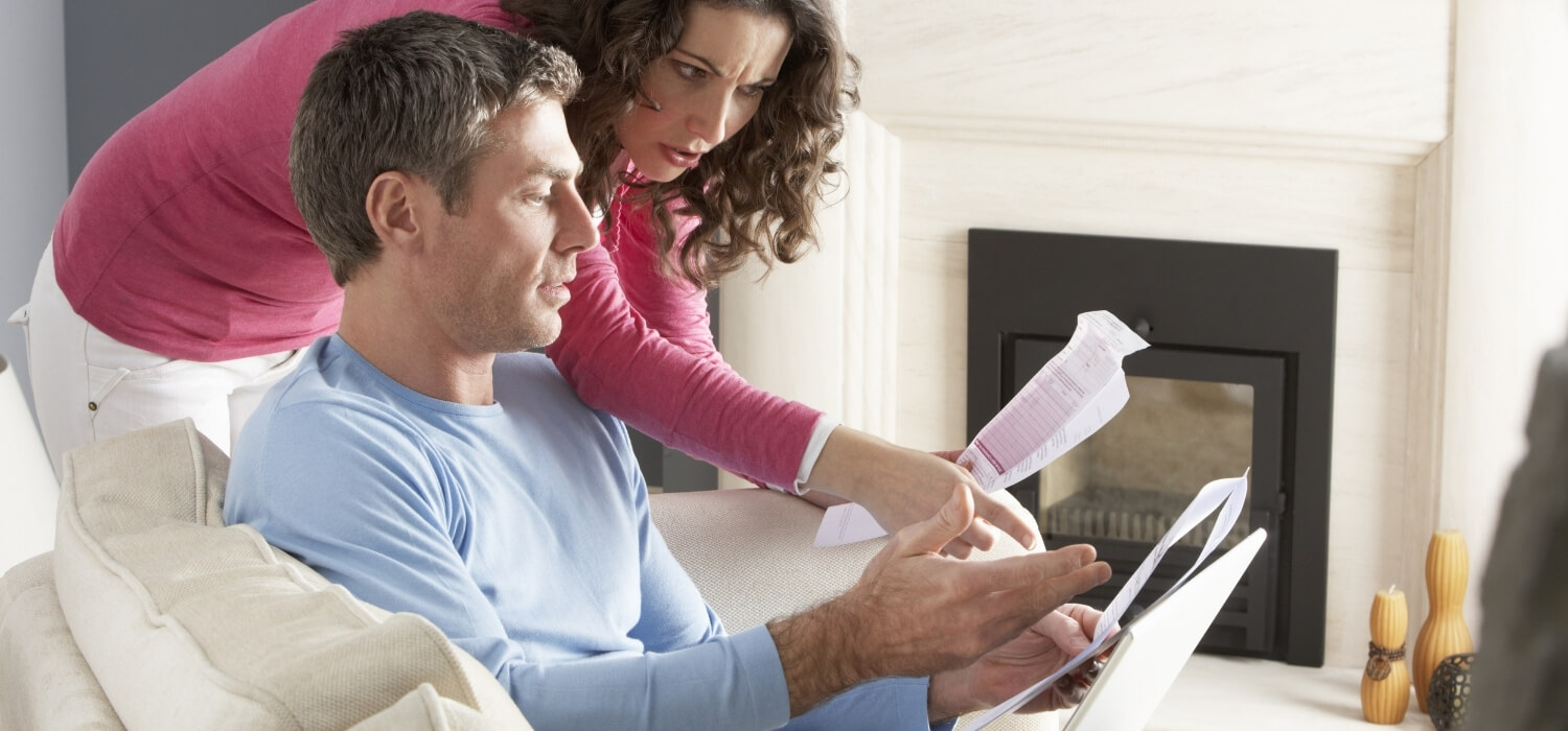 Couple Looking at Large Heating Bills