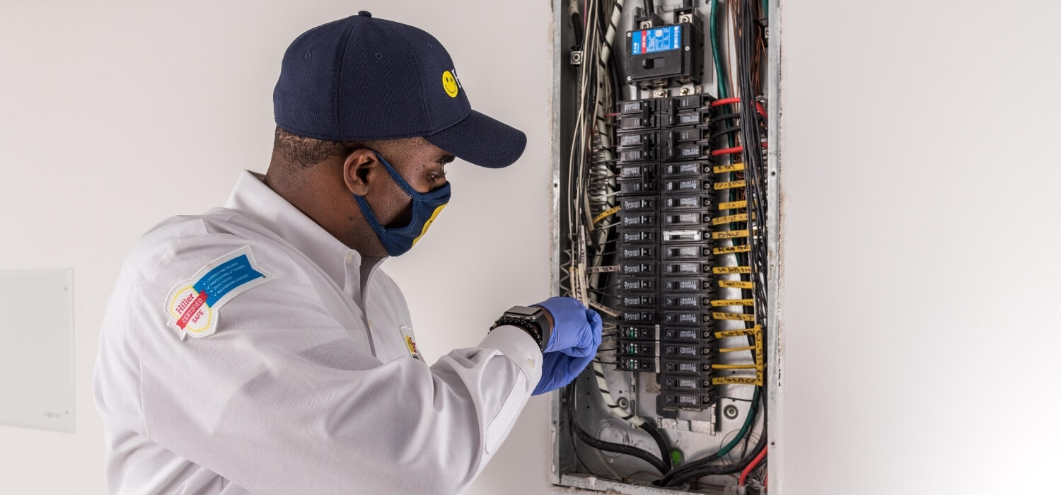 Electrician Working on Overloaded Circuit