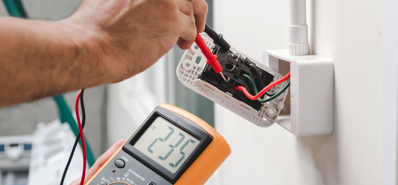 Homeowner Reading Voltage on Socket