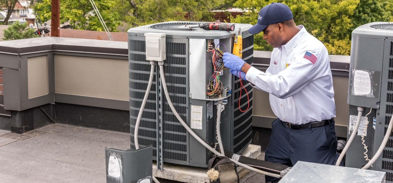 Hiller HVAC Technician Repairing HVAC Unit on Roof