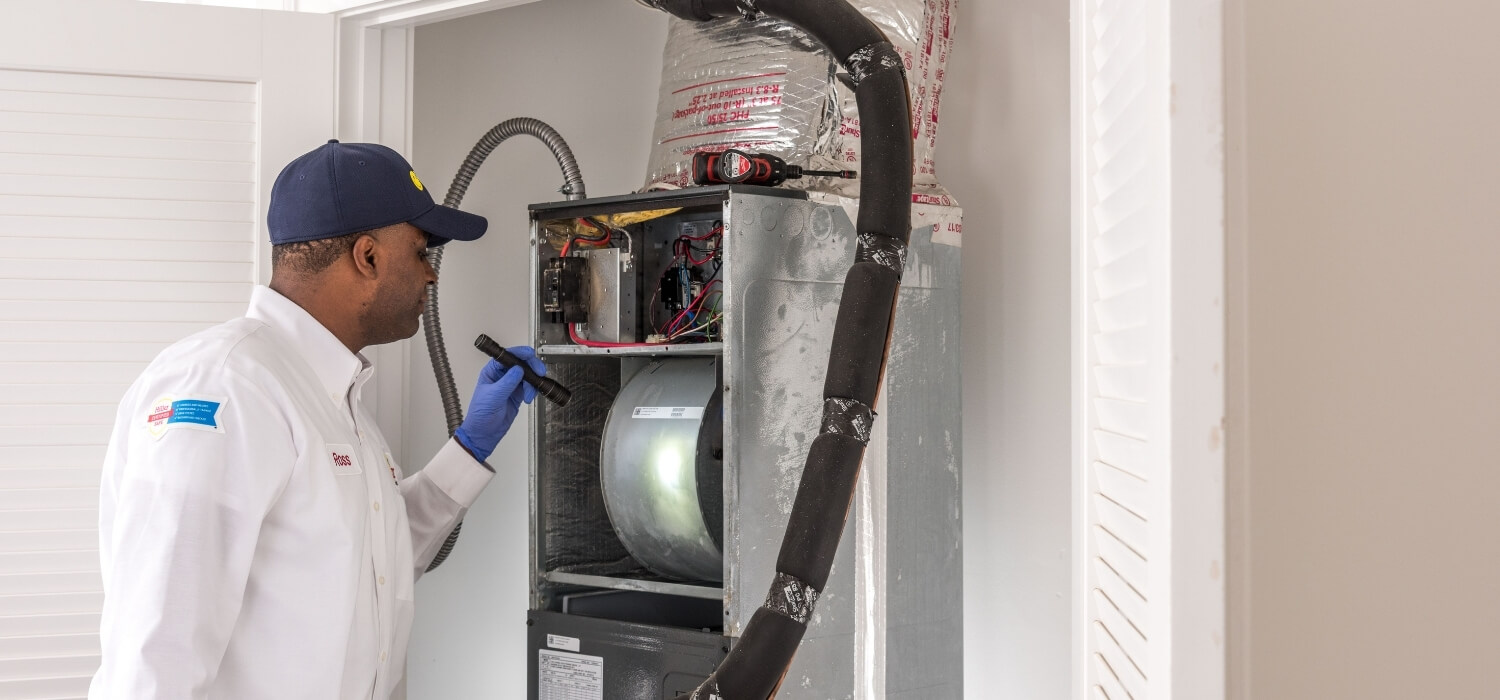 Hiller HVAC Technician Performing Tune-Up on Heating Unit