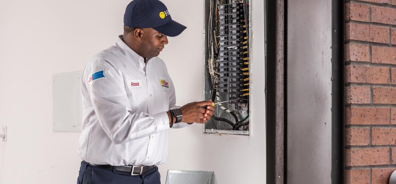 Hiller Electrician Working on Breaker Panel