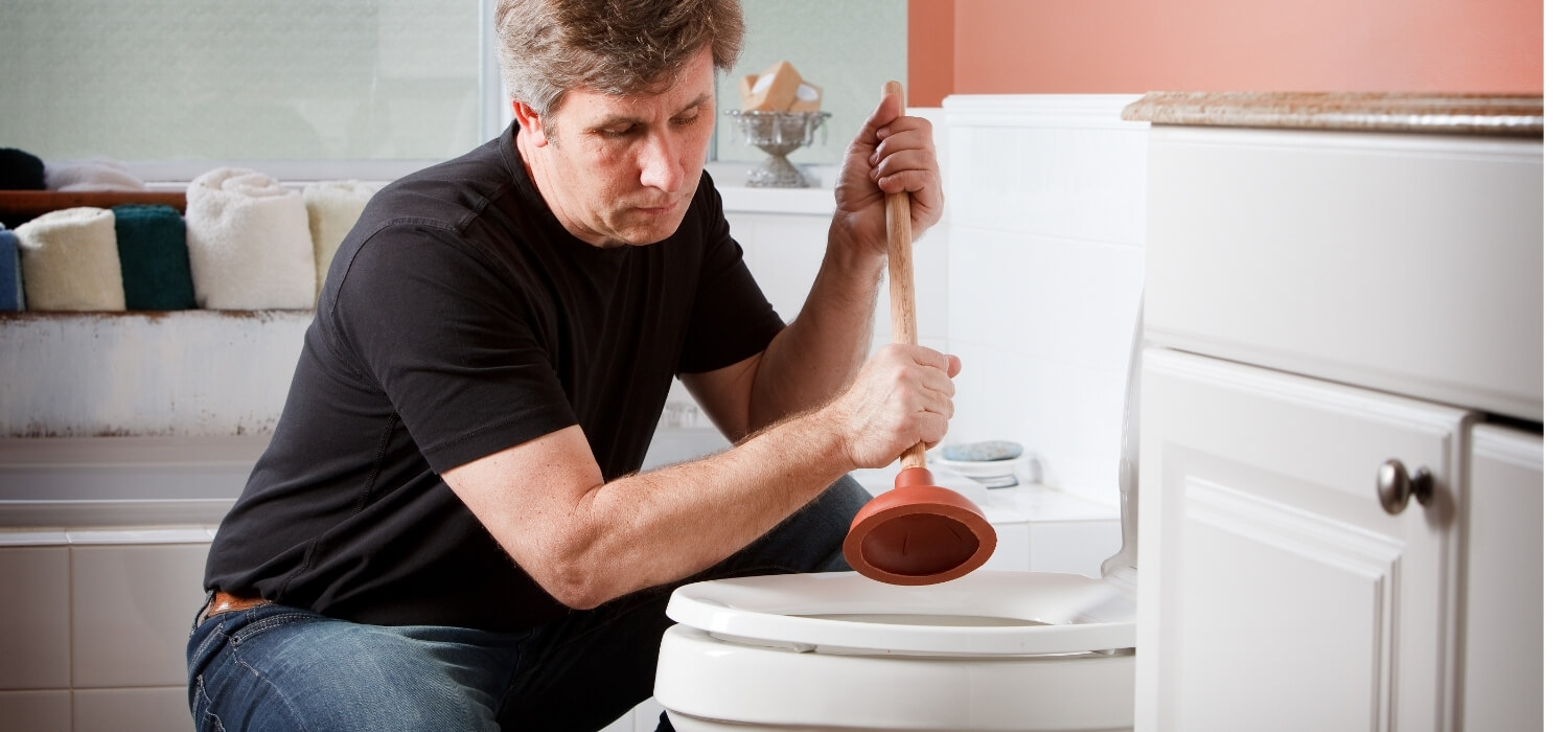Homeowner Using Plunger to Unclog Overflowing Toilet
