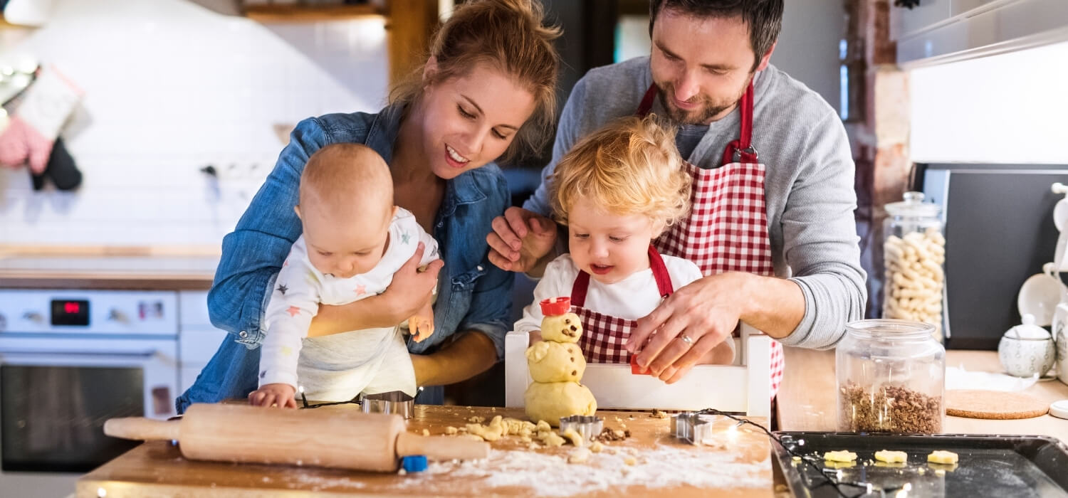 Family making Cookies During Winter Day