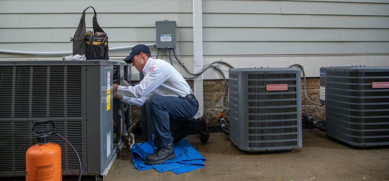 HVAC Technician Performing AC Maintenance