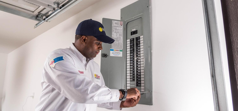 Electrician Replacing Circuit Breaker Panel