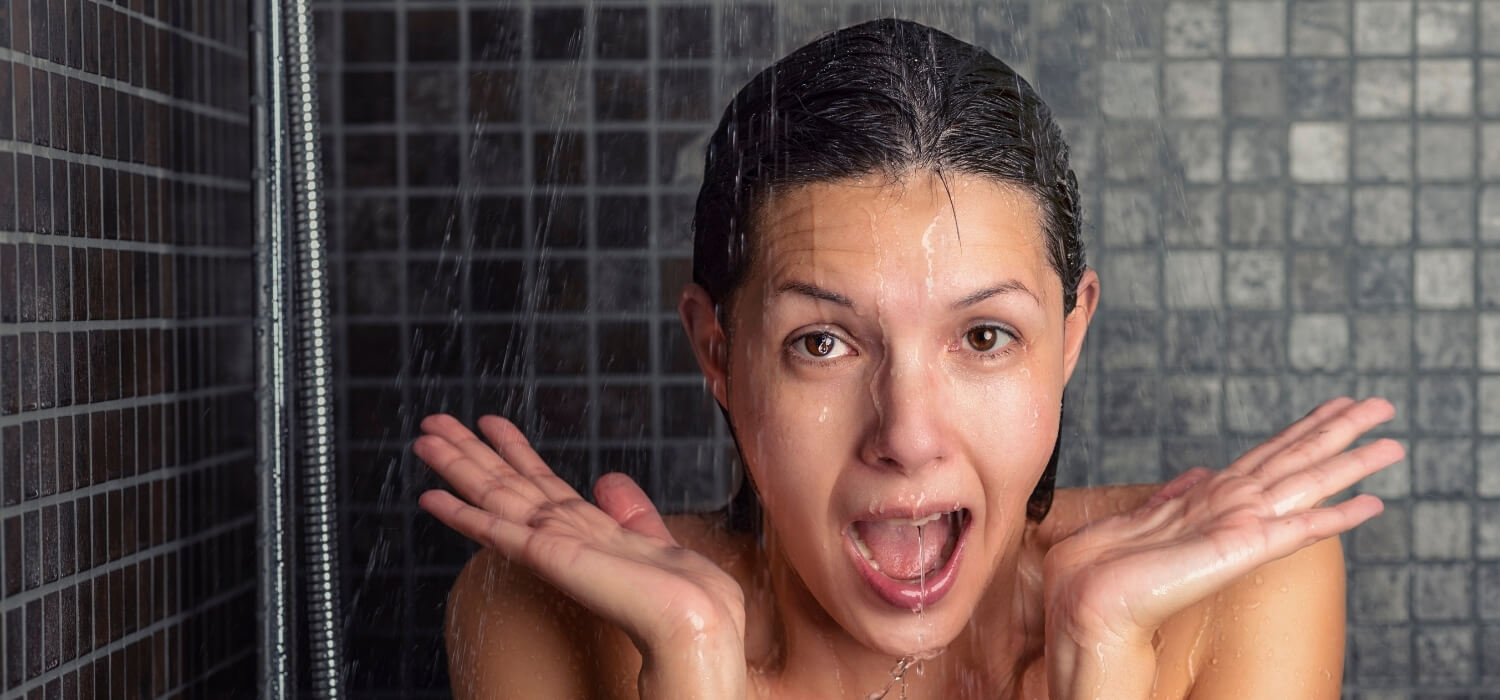 Lady Surprised with Cold Water in Shower