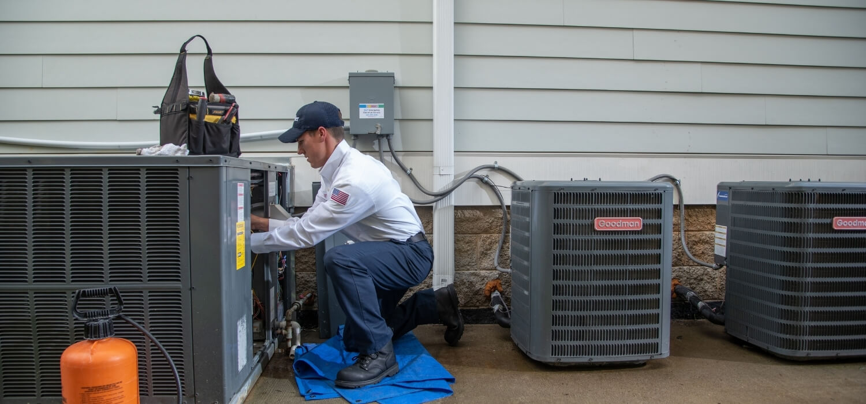 Hiller HVAC Technician Repairing Unit