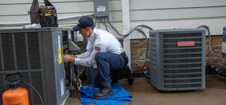 HVAC Technician Performing Maintenance