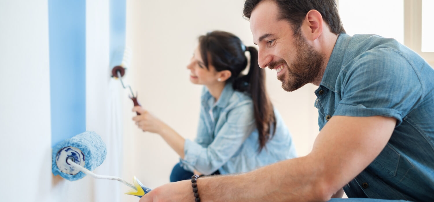 Couple Renovating Room by Painting