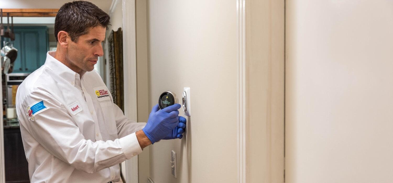 HVAC Technician Installing a New Smart Thermostat