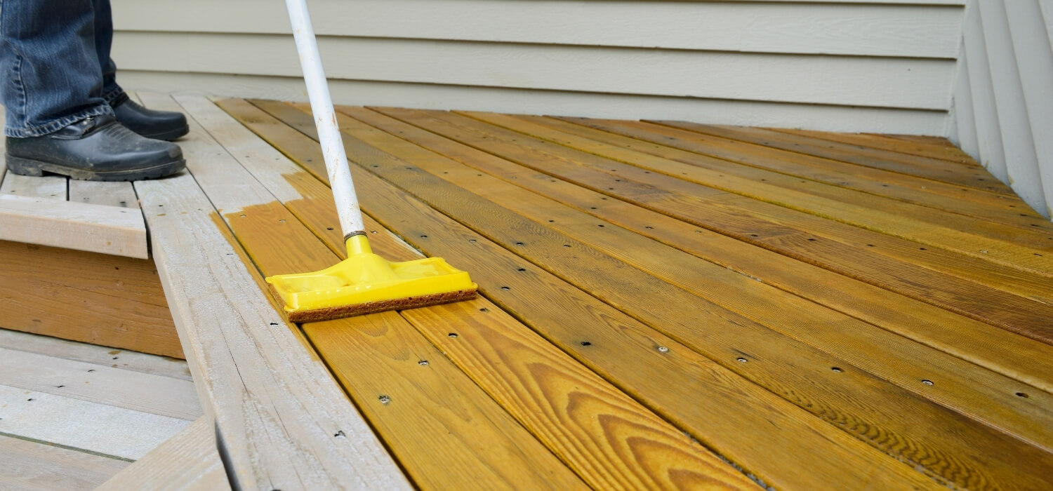 Homeowner Staining their Renovated Deck