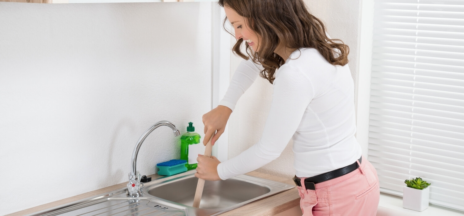 Lady Needing a Plumbing Emergency with a Clogged Drain