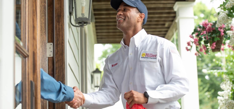 Hiller Technician Greeting Homeowner for Gas Furnace Maintenance